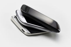 3 Smartphones On Top Of Each Other Stock Photos