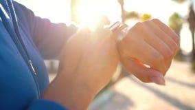 Smartwatch. Woman using smart watch. Closeup of female touching touch screen on watch, entering watch app before run. Smartwatch concept. Woman using smart watch stock video