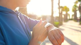 Smartwatch. Woman using smart watch. Closeup of female touching touch screen on watch entering watch app and starts to. Smartwatch concept. Woman using smart stock video footage