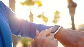 Smartwatch. Woman using smart watch. Closeup of female touching touch screen on watch entering watch app