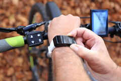 Smartwatch and E-Mountainbike Stock Photography
