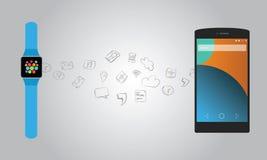 Smartwatch e smartphone Imagens de Stock