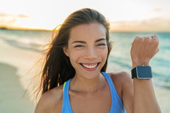 Smartwatch happy girl showing screen on watch. Smartwatch happy girl showing display screen on trendy new smart watch fitness tracker wristwatch. Healthy young Royalty Free Stock Photo