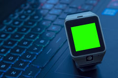 Smartwatch near computer pc keyboard with chroma key green screen Royalty Free Stock Images