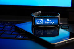 Smartwatch with New Message notification on the display. Stock Photos