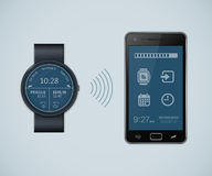 Smartwatch and smartphone communication Stock Photo