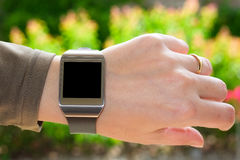 Smartwatch on the turned wrist Royalty Free Stock Photography