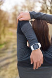 Smartwatch woman running with heart rate monitor Stock Photos