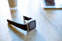 Smartwatch on wooden table Royalty Free Stock Photos