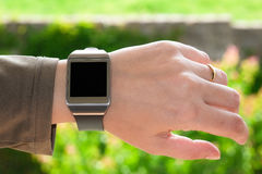 Smartwatch on the wrist Royalty Free Stock Image