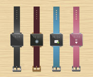 Smartwatches set. Four colors. Wooden background Stock Image