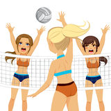 Smash Block Women Volleyball Players. Active volleyball player woman jumping while two adversaries try to block smash attack Stock Photography