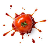 Smash tomato. Crushed or splattered tomato with ketchup isolated on white Stock Photography