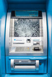 Smashed ATM. ATM Smashed by mob members. it's dangerous to use because shattered glass Royalty Free Stock Photography