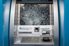 Smashed ATM. ATM Smashed by mob members. it's dangerous to use because shattered glass Stock Photography