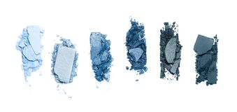 A smashed, blue toned eyeshadow make up palette isolated on a white background. Smashed, blue toned eyeshadow make up palette isolated on white background stock images