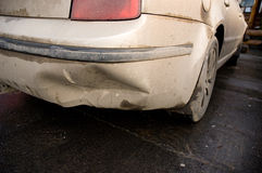 Smashed bumper. Dirty white car with smashed bumper Royalty Free Stock Photo