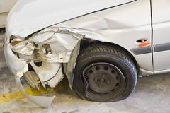 Smashed Car. Car With Smashed Front Fender And A Flat Tire Stock Photos