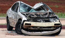 Smashed Car. A smashed car sitting in the road Royalty Free Stock Images