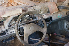 Smashed car cockpit wreck. Left neglected in barn wreck Royalty Free Stock Image
