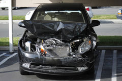 Smashed car front. A front view of a car smashed up in a collision Royalty Free Stock Photos