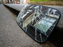 Smashed car rear view mirror terrace house Stock Photo