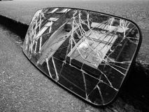 Smashed car rear view mirror terrace house Royalty Free Stock Images