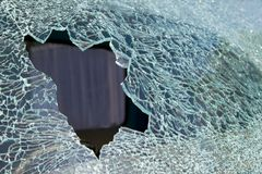 Smashed car window. Looking through to the back window of a pick-up royalty free stock images