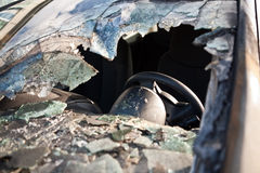 Smashed car window. A car window has been broken in thousand pieces royalty free stock photo