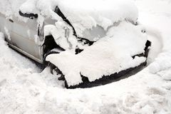 Smashed Car In Winter. Abandoned smashed car in the snow, outdoor shot Stock Photo