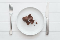 Smashed chocolate easter egg on a plate Royalty Free Stock Image