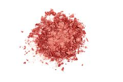 Smashed coral eyeshadow isolated on a white background. royalty free stock image