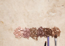 Smashed eye shadows. Smashed eyeshadows on a marble background Royalty Free Stock Photos