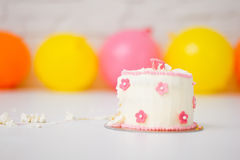 Smashed first birthday cake Royalty Free Stock Photography