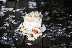 Smashed first birthday white cake with stars and one candle for little baby boy and decorations. Black background stock image