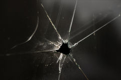 Smashed glass window. Close up of smashed glass window with small black hole Royalty Free Stock Photography