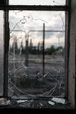 Smashed Glass Window Frame with Blurred Background Stock Photo