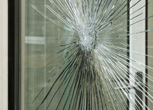 Smashed glass window pane Stock Photo
