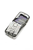 Smashed mobile phone. Smashed cellular phone isolated on the white background Royalty Free Stock Photos