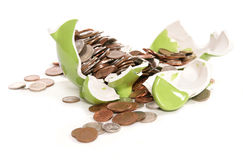 Smashed moneybox with British currency coins Stock Photos