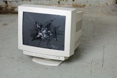 Smashed monitor. Smashed computer monitor in the cellar Stock Photos