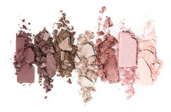 A smashed, neutral toned eyeshadow make up palette isolated on a white background Royalty Free Stock Photos