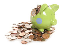 Smashed piggy bank with British currency coins Royalty Free Stock Images