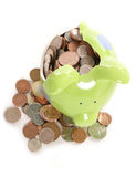 Smashed piggy bank with British currency coins. Smashed piggy bank moneybox with British currency coins Royalty Free Stock Images