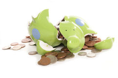 Smashed piggy bank with British currency coins. Smashed piggy bank moneybox with British currency coins Stock Photography
