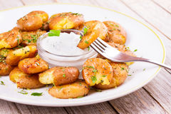 Smashed Potatoes with parsley and rosemary. Smashed Potatoes with parsley and rosemary Royalty Free Stock Photography