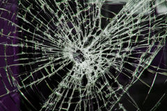 Smashed  window. A closeup of a broken glass window Royalty Free Stock Photos
