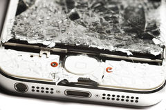 Smashed smart phone. Screen and button Royalty Free Stock Images