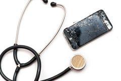 Smashed Smartphone and stethoscope Royalty Free Stock Image