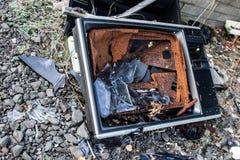 Smashed TV. Smashed and abandoned TV. Taken near Dundee, Scotland stock images